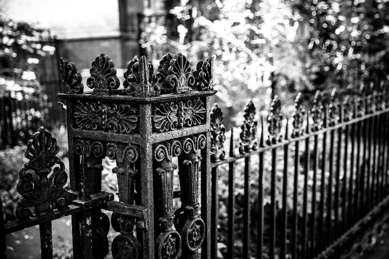 gate, focus on foreground, railing, protection, outdoors, no people, day, close-up, architecture, tree