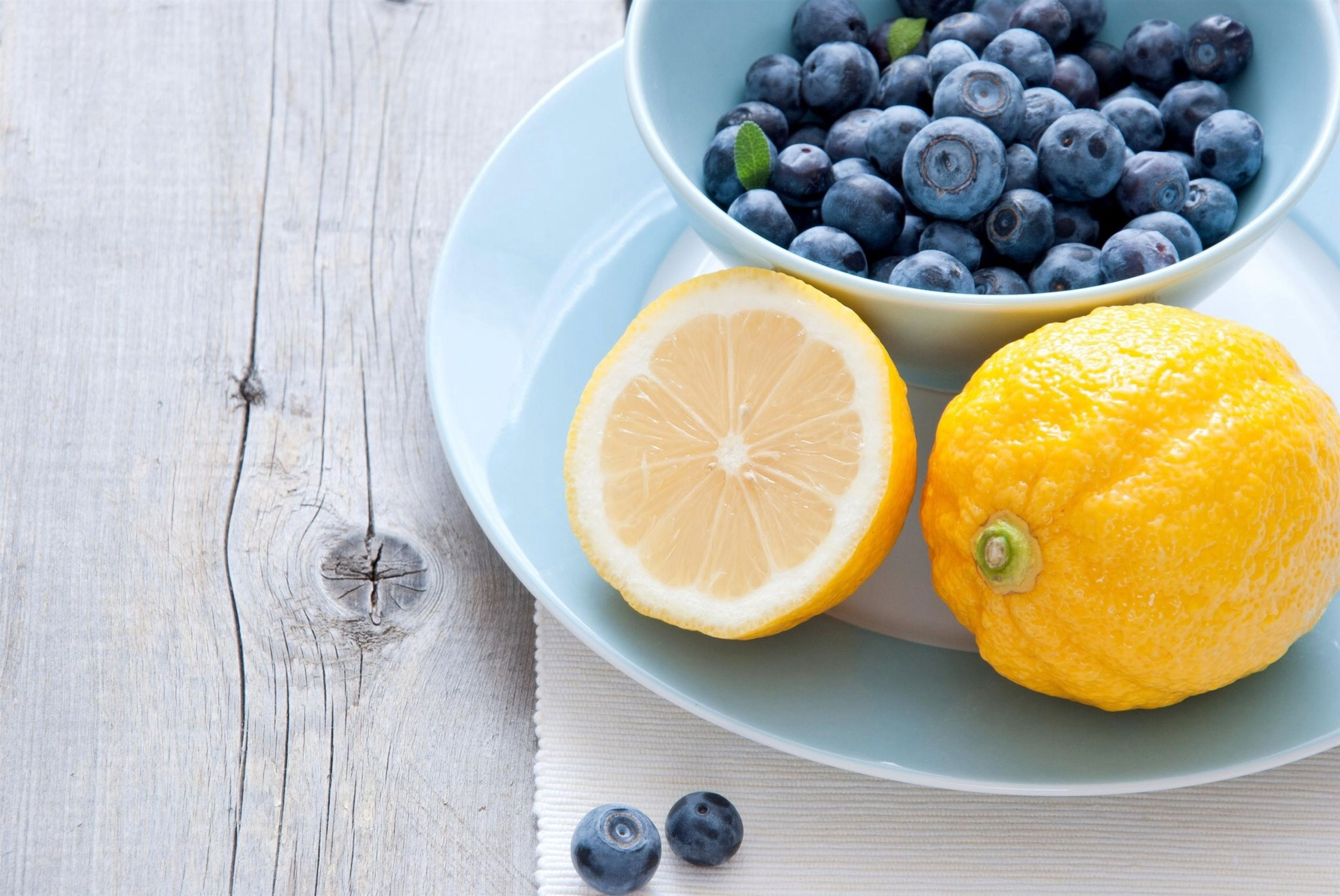 food and drink, food, freshness, healthy eating, fruit, bowl, indoors, table, still life, directly above, high angle view, plate, yellow, circle, no people, overhead view, close-up, organic, orange - fruit, ripe