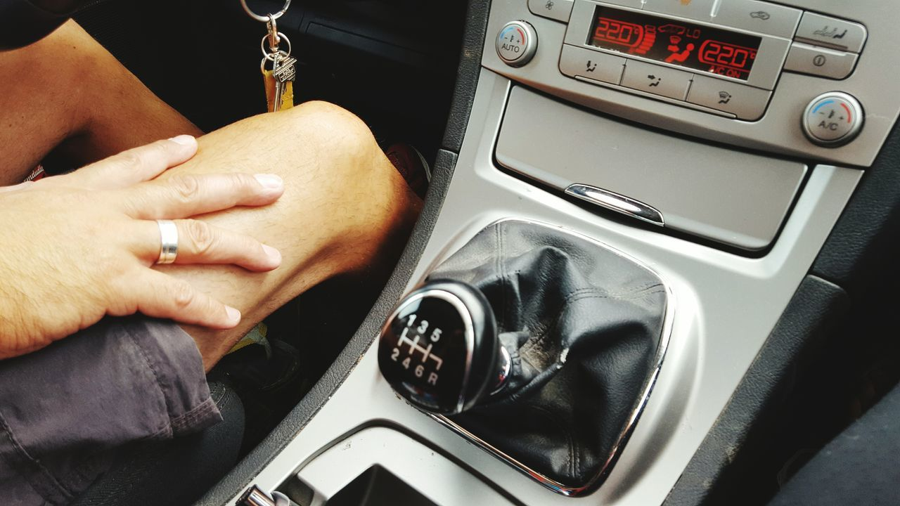 vehicle interior, car interior, car, human hand, transportation, dashboard, mode of transport, land vehicle, steering wheel, one person, human body part, real people, speedometer, close-up, indoors, gauge, day, people
