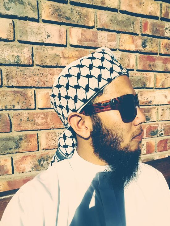 The Portraitist - 2017 EyeEm Awards Sunglasses One Person One Man Only Adults Only Brick Wall Headshot Eyeglasses  Mustache Human Face Lifestyles Outdoors Day Leisure Activity The Great Outdoors - 2017 EyeEm Awards Bearded Turbanstyle Kurta Muslim Happiness Passion Motivation Port Elizabeth, South Africa 🇿🇦 South Africa Photograph