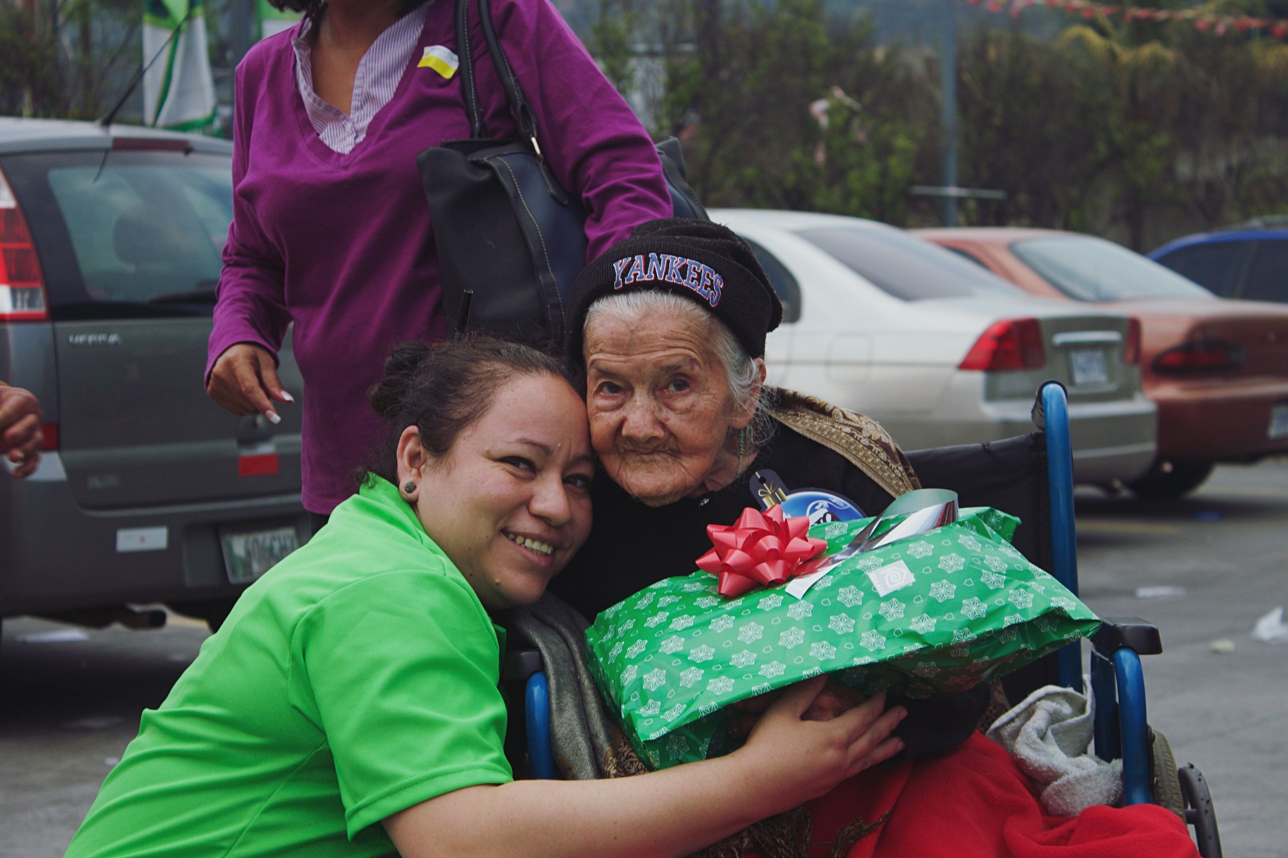 two people, car, family, mature adult, love, togetherness, men, transportation, father, holiday - event, travel, vacations, mature men, child, leisure activity, packing, females, adult, parent, celebration, women, land vehicle, people, bonding, christmas, outdoors, happiness, gift, cheerful, day, smiling, christmas tree, passenger seat, close-up, unity