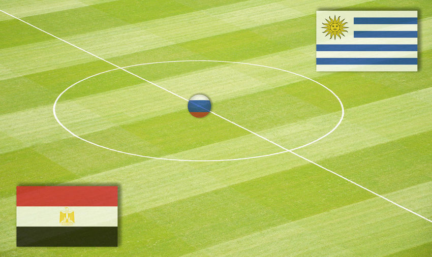Soccer field with the World Cup mating Egypt against Uruguay Egypt Eighth-Finals Football Group Stage Group Games National Team Russia Saudi Arabia Semi-Finals Stadium World Championship World Cup Mating World Ranking Club Final Football Field Football Pitch Group Play Group Plays Middle Circle Play Matings Round Of The Last Sixteen Uruguay World Championship Mating World Cup