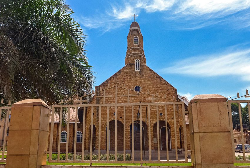 a church in Kampala Uganda, Africa, Arch Architecture Building Exterior Built Structure Cloud - Sky Day History Kampala,uganda Low Angle View No People Outdoors Place Of Worship Religion Sky Spirituality Travel Destinations Tree