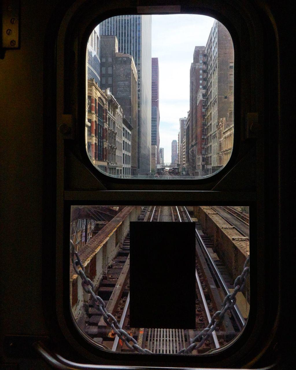 Buildings In City Seen Through Train Window