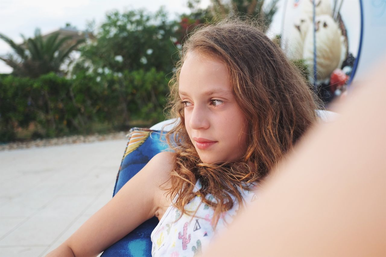 Girl enjoying her summer holidays at the beach. One Person Leisure Activity Real People Young Adult Casual Clothing Young Women Lifestyles Focus On Foreground Outdoors Day Childhood Headshot Looking At Camera Girls Sitting Close-up People Smile Authentic Moments Happy Tranquility