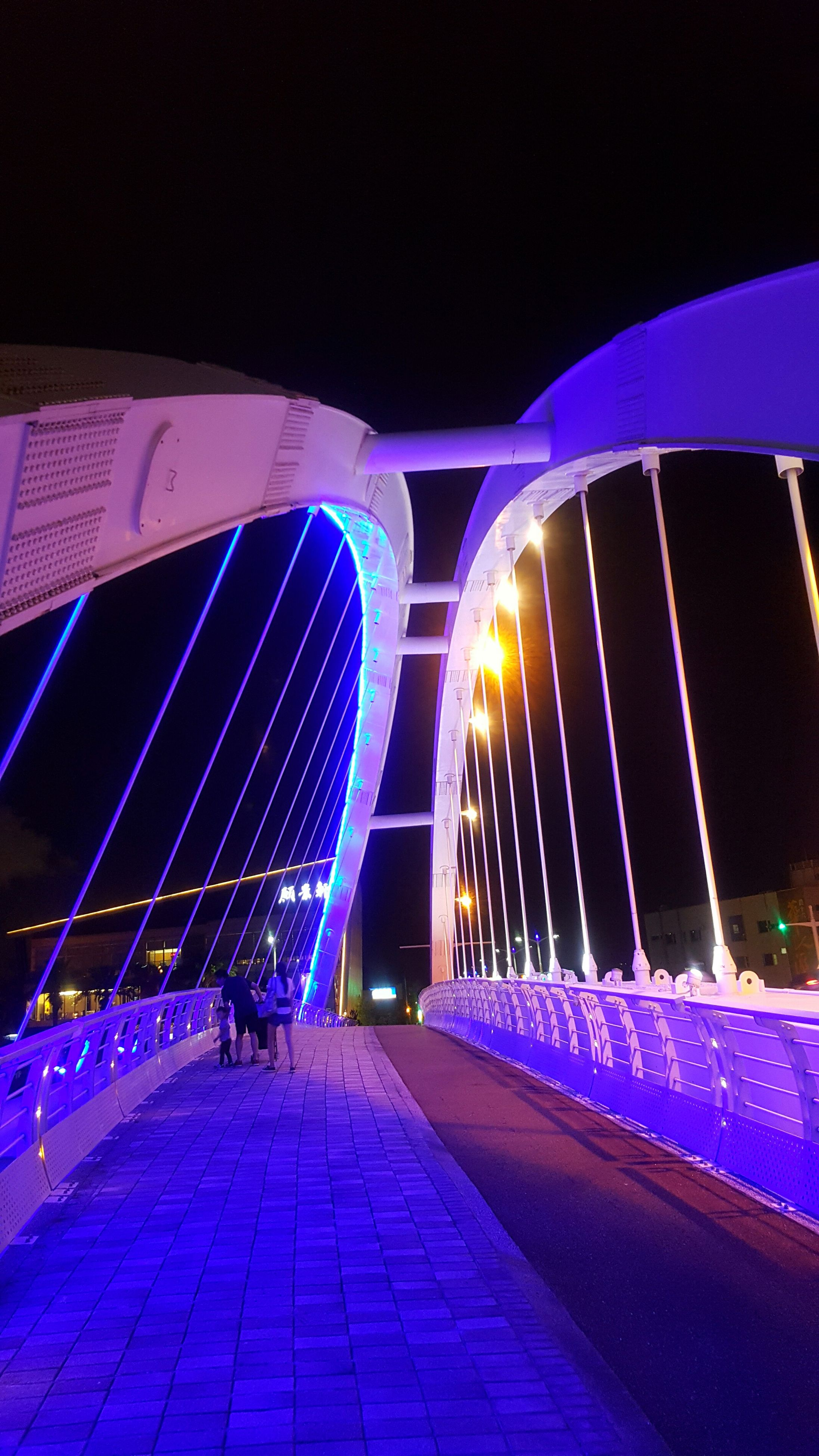 night, illuminated, real people, connection, the way forward, transportation, bridge - man made structure, modern, blue, architecture, built structure, men, outdoors