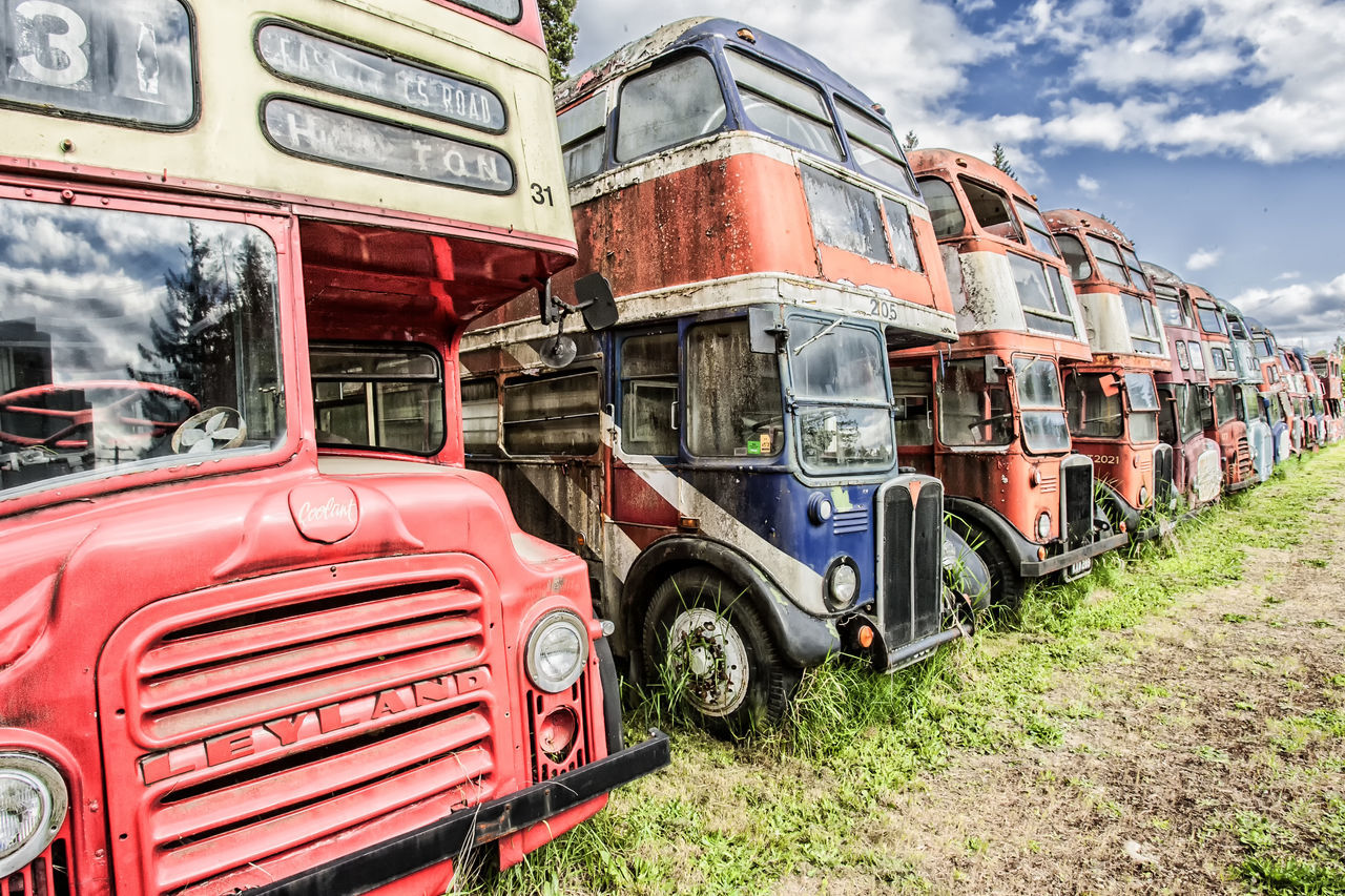 transportation, mode of transport, land vehicle, cloud - sky, day, outdoors, no people, red, stationary, sky