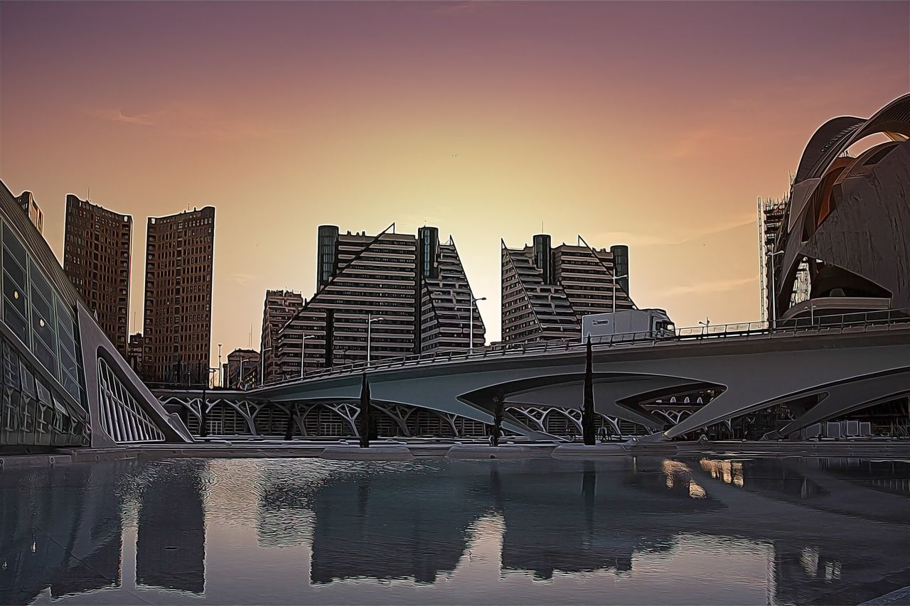 architecture, bridge - man made structure, connection, sunset, built structure, city, skyscraper, modern, urban skyline, sky, cityscape, building exterior, no people, outdoors, day