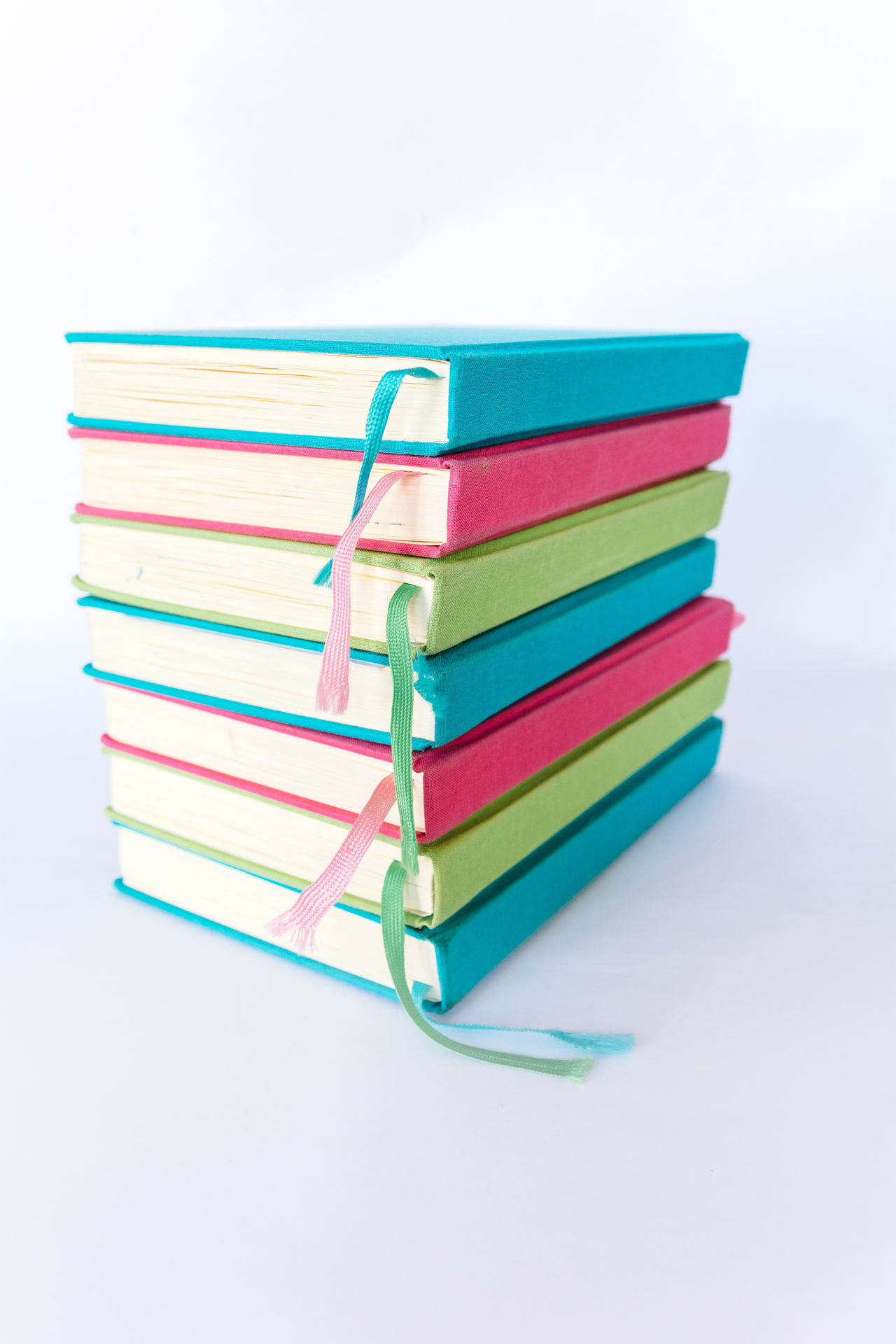 Colorful Books Blue Books Colorful Colors Cyan Day Education Educational Green Green Color Learning LearningEveryday Multi Colored No People Pink Reading Reading Books Reading Time Stack Study Hard Study Time Studying Symbol Variation White Background