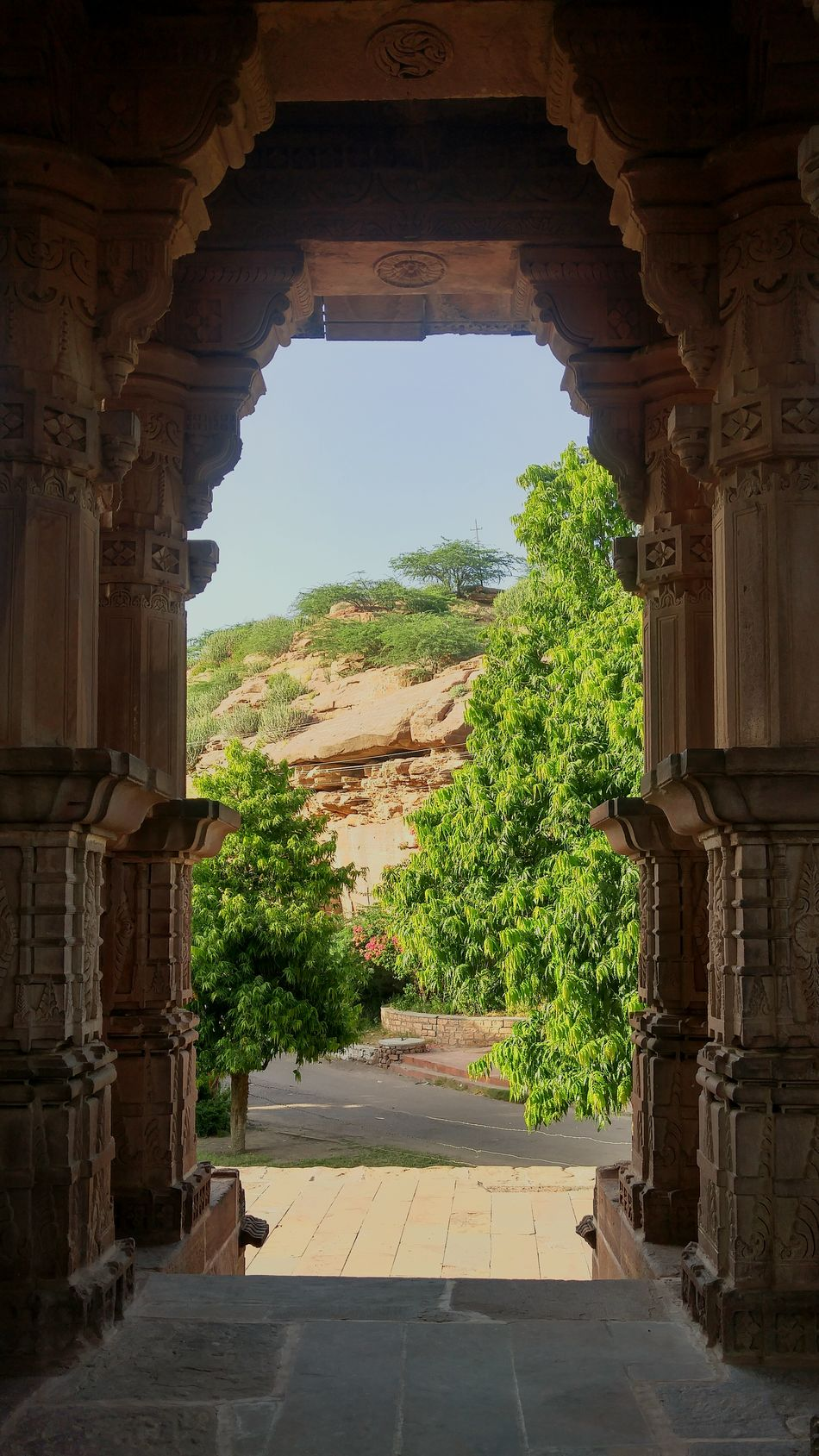 Rajasthandiaries IncredibleindiaRural Scene Place Of Worship Old Buildings Architecture Carvings Historical Greenery Day Sunlight ☀ Hot Weather Gate Hill Shelter Travel Destinations Rajasthan_diaries Miles Away