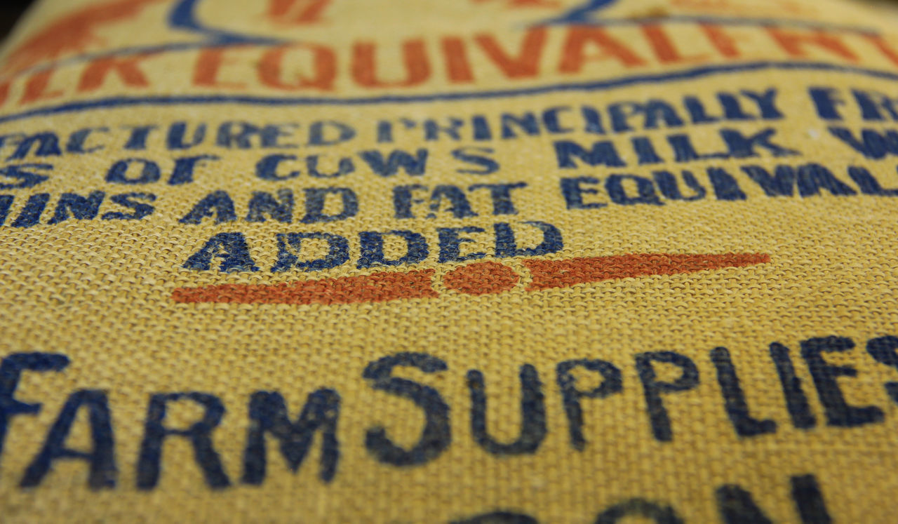 Sack close up Bag Blue Close-up Communication Day Extreme Close-up Farm Hessian Indoors  No People Sack Text Yellow