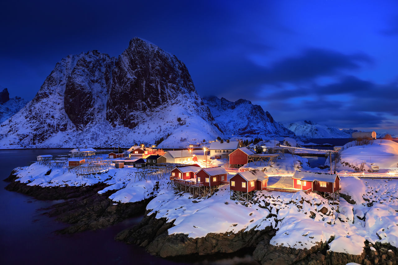 The fisherman village Hamnoy on Lofoten Islands by night, Norway Architecture Barents Sea, Hamnoy, Lofoten Islands, Northern, Reine, Town, Arctic, Atlantic, Coast, Cold, Europe, Fishing, Fjord, Harbor, Holiday, Ice, Landscape, Mountains, Nature, Night, Nordic, Nordland, North, North Sea, Norway, Norwegian, Ocean, Outdoor, Outdoors, Beauty In Nature Blue Building Exterior Cold Temperature Dusk House Illuminated Mountain Nature Night No People Outdoors Scenics Sky Snow Town Winter