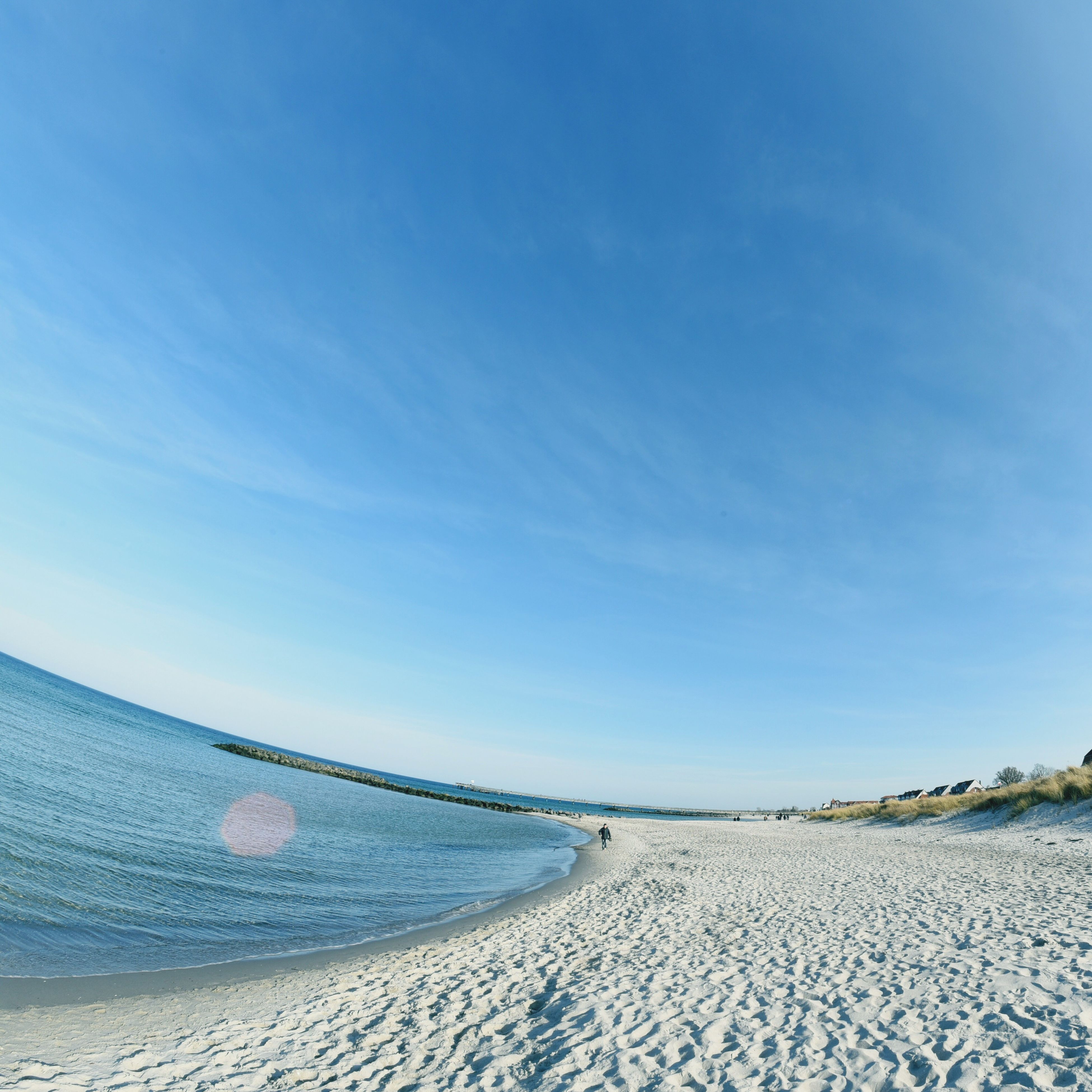 beach, sea, sand, blue, tranquility, tranquil scene, scenics, beauty in nature, sky, water, nature, shore, horizon over water, sunlight, idyllic, day, outdoors, remote, non-urban scene, no people