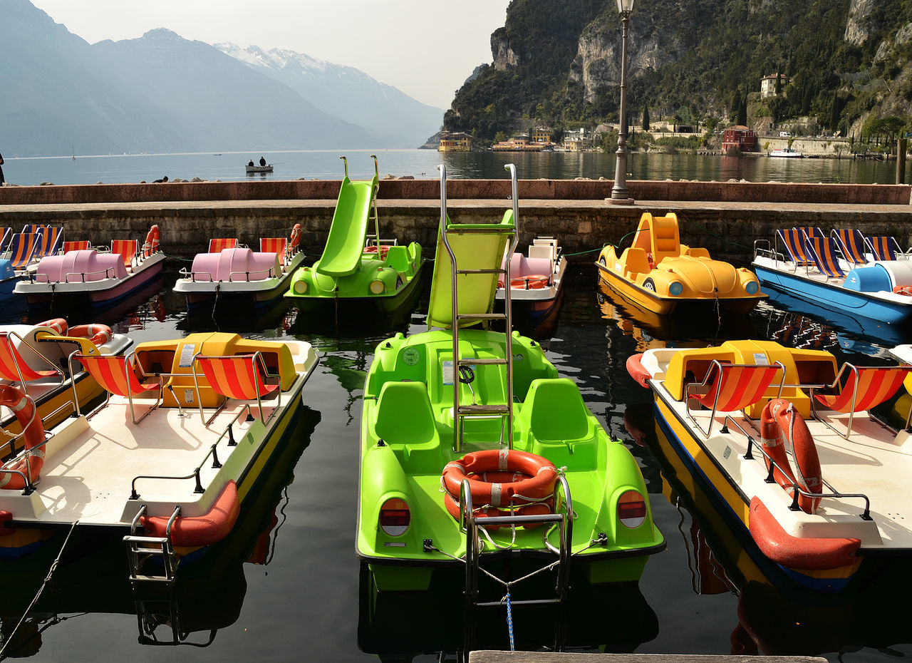 Arranged Arrangement Boat Harbour Holiday Lake Garda Large Group Of Objects Mountain Multi Colored No People Order Riva Del GRD Standing Water Tourism Tourist Attraction  Variation Various Waiting Boat Water Waterfront