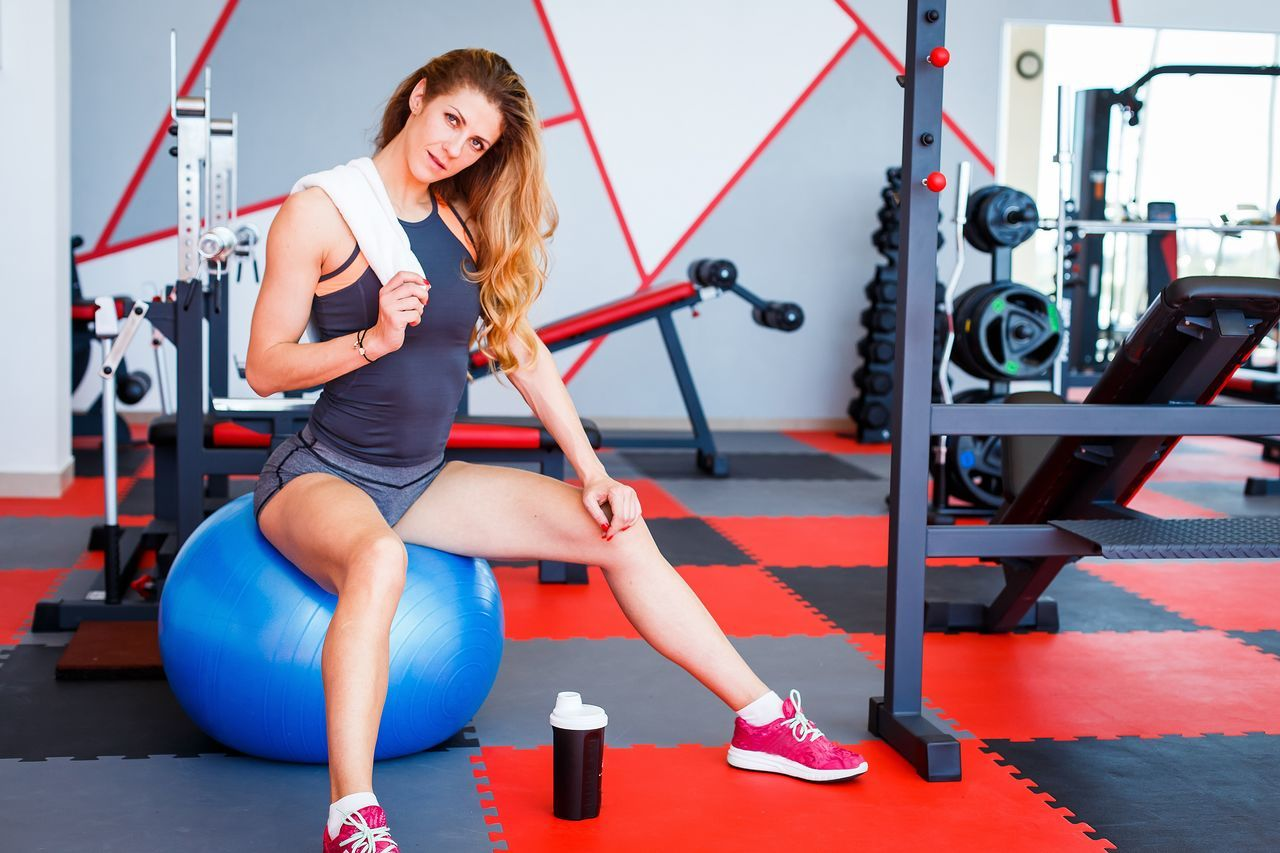 Body Care Body Conscious Dumbbell Exercise Equipment Exercising Full Length Gym Health Club Healthcare And Medicine Healthy Lifestyle Lifestyles Muscular Build Relaxation Exercise Rest Resting Sitting Smiling Sport Sports Clothing Sports Training Strength Towel Young Adult