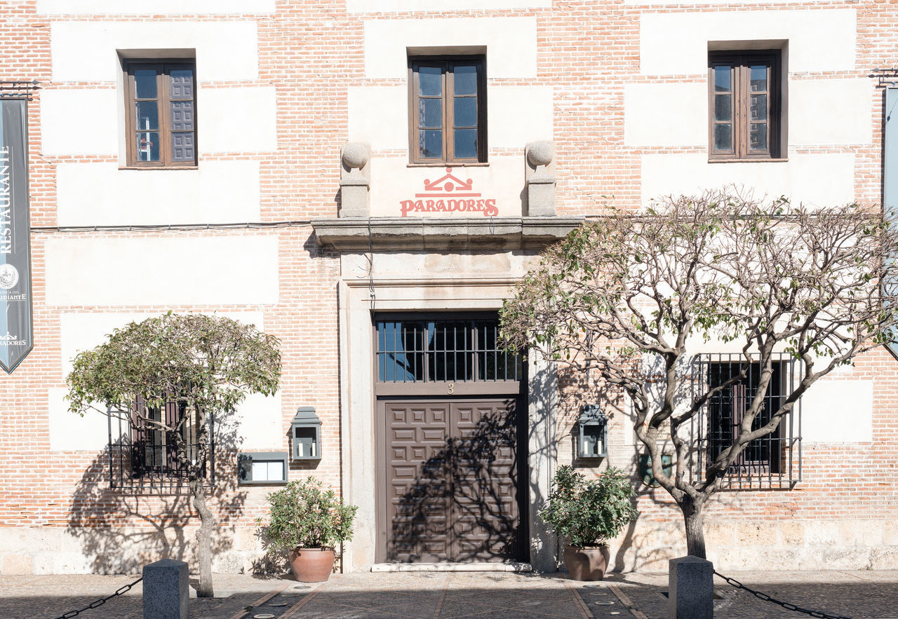 Alcala de henares, madrid, Spain-FEBRUARY 25, 2017. Student hostel, very famous restaurant Architecture Building Exterior Built Structure Clock Day Exit Sign Hospital No People Outdoors Text Tree Window