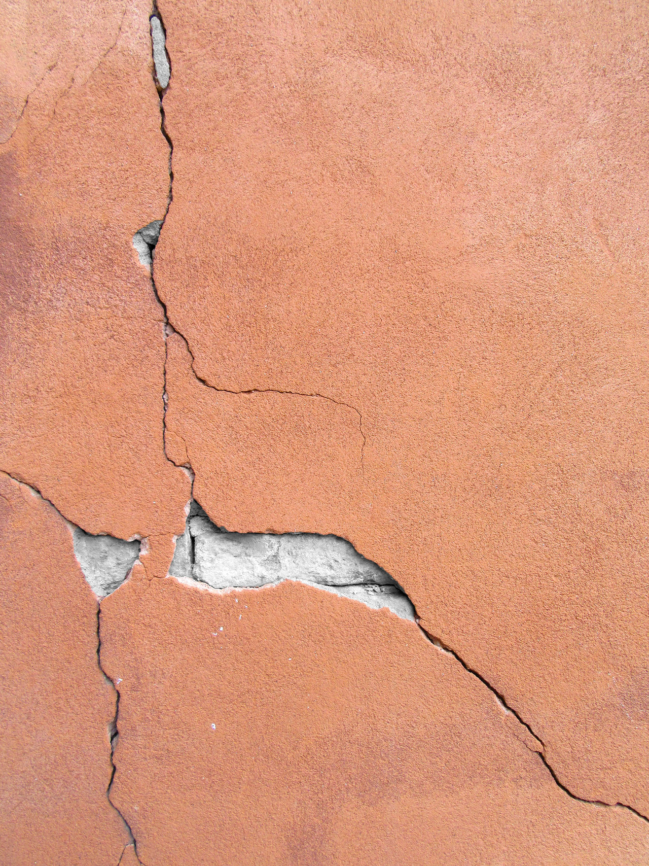 Cracked plastered concrete wall Abstract Arid Climate Backgrounds Brown Close-up Cracked Damaged Day Dividing Full Frame Geology Nature No People Orange Outdoors Paint Pattern Textured  Textured Effect Weathered