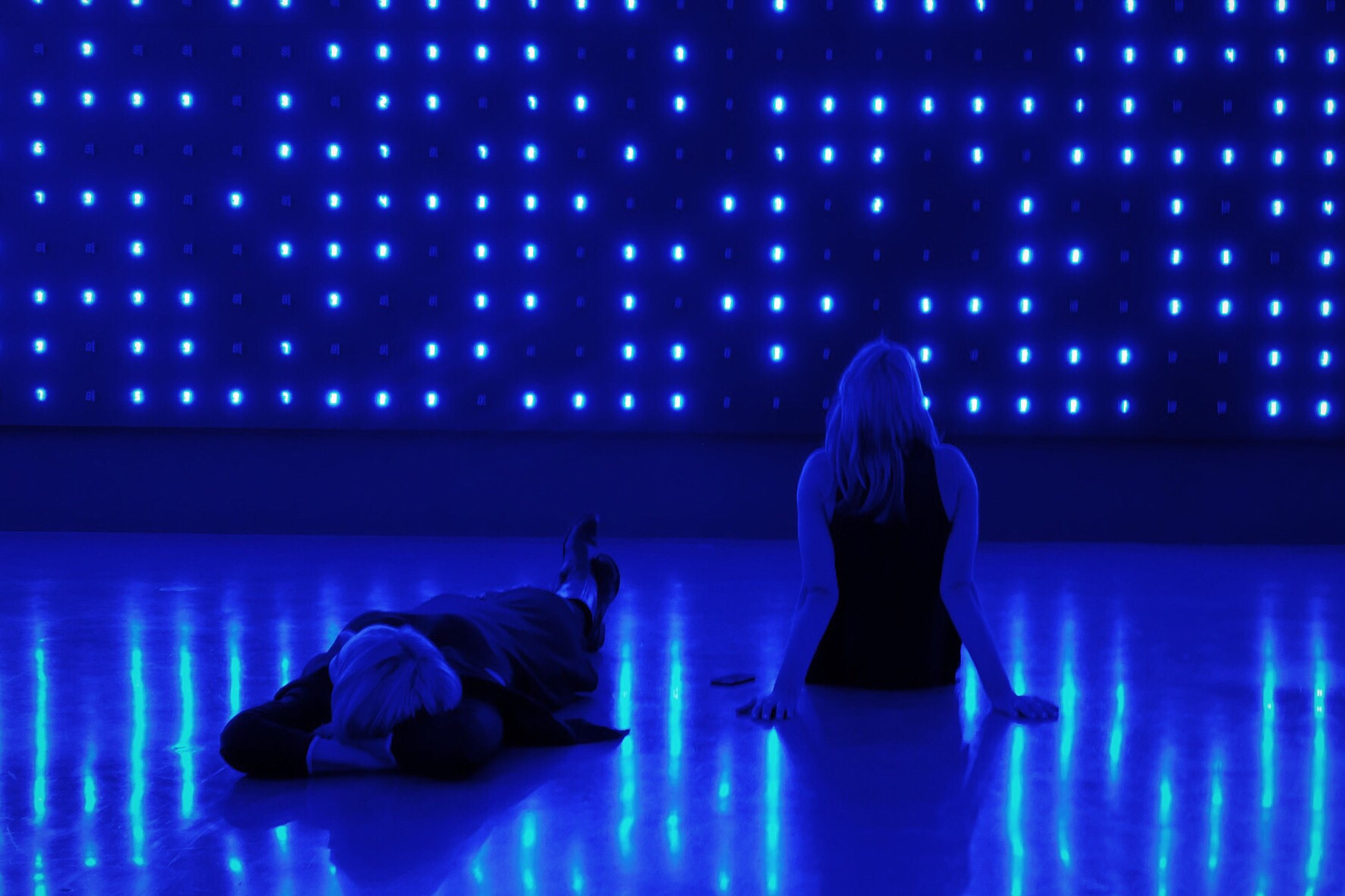 full length, blue, two people, real people, rear view, night, leisure activity, lifestyles, togetherness, stage - performance space, people, indoors, adult