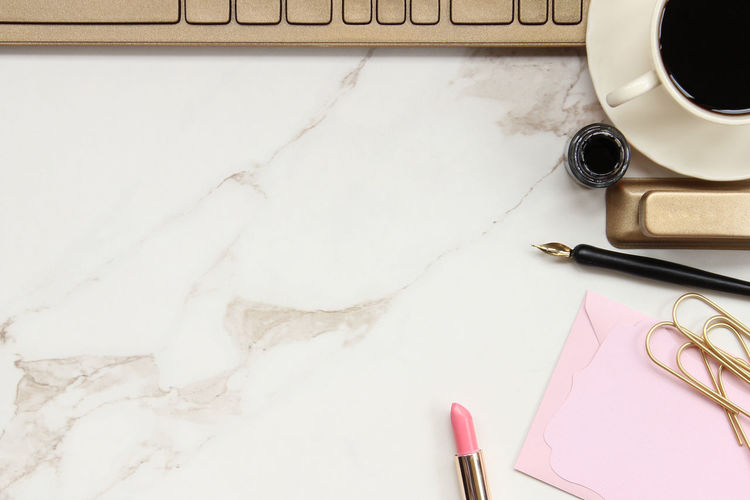 Solid Gold Office space Beautiful Business Chic Coffee Cup And Saucer Desk Top Feminine  Glamour Gold Office Gold Office Supplies Keyboard Marble Desk Mock Up Modern Office Office Space Overlay Productivity Room For Copy Solid Gold Styled Technology Template Top View Work