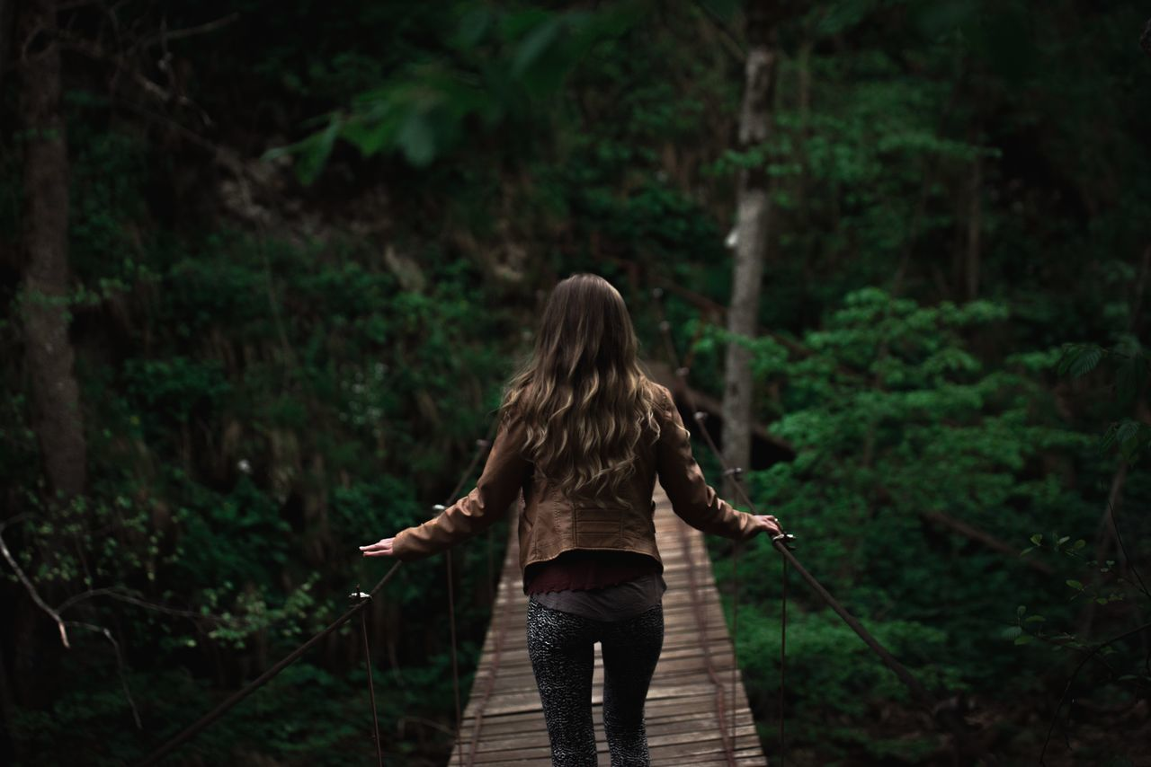 Adult Adults Only Adventure Bridge Bridge - Man Made Structure Day Forest Forest Photography Green Green Color Leisure Activity Long Hair Nature Nature One Person One Woman Only One Young Woman Only Only Women Outdoors People Rear View Tree Woman Women Young Adult