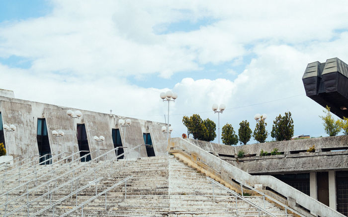 Boro and Ramiz #0 1977 Architecture Architecture Balkan Boro And Ramiz Brutal Brutalism Building Exterior Built Structure Cloud - Sky Day Kosova Kosovo Low Angle View No People Outdoors Palace Of Youth And Sports Pristina Pristine Sky The Architect - 2017 EyeEm Awards Travel Tree