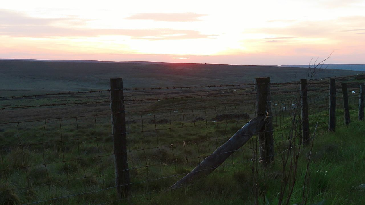 fence, sunset, protection, barbed wire, safety, landscape, field, wooden post, security, gate, scenics, tranquil scene, grass, no people, tranquility, nature, sky, rural scene, paddock, mountain, sun, beauty in nature, outdoors, day