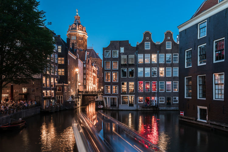 Bring on the night Amsterdam Architecture Blue Blue Hour Building Exterior Built Structure Canal Capital Cities  City City Life Classic Dutch Europe Holland Illuminated Long Exposure Nederland Netherlands Old Buildings Old Town Outdoors Red Light District Travel Destinations UNESCO World Heritage Site Water
