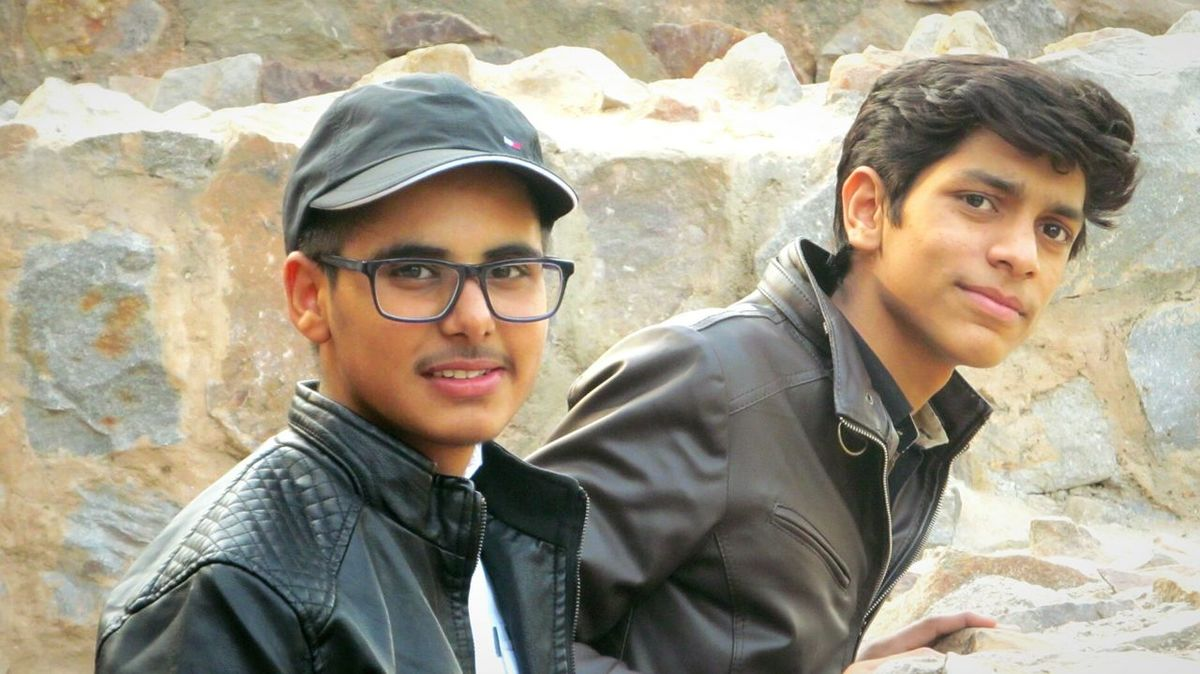 Uniqueness Only Men Portrait Looking At Camera Eyeemphotography EyeEmNewHere Young Adult Eyeglasses  Headshot Adult People Adults Only Friendship Sunglasses Outdoors Two People Close-up Day Happiness Smiling Togetherness Bright Jacket Hauzkhasfort Taking Photos