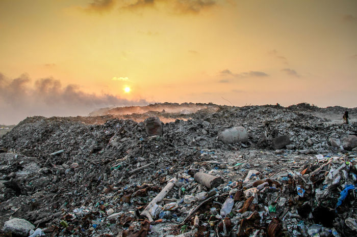 Waste plastic bottles and other types of plastic waste at the Thilafushi waste disposal site at sunset Bottle Burning Plastic Can Cup Dumping Rubbish Global Warming Grabage Landfill Outdoors Pile Plastic Waste Polution Recycle Reuse Sunset Trash Wastland
