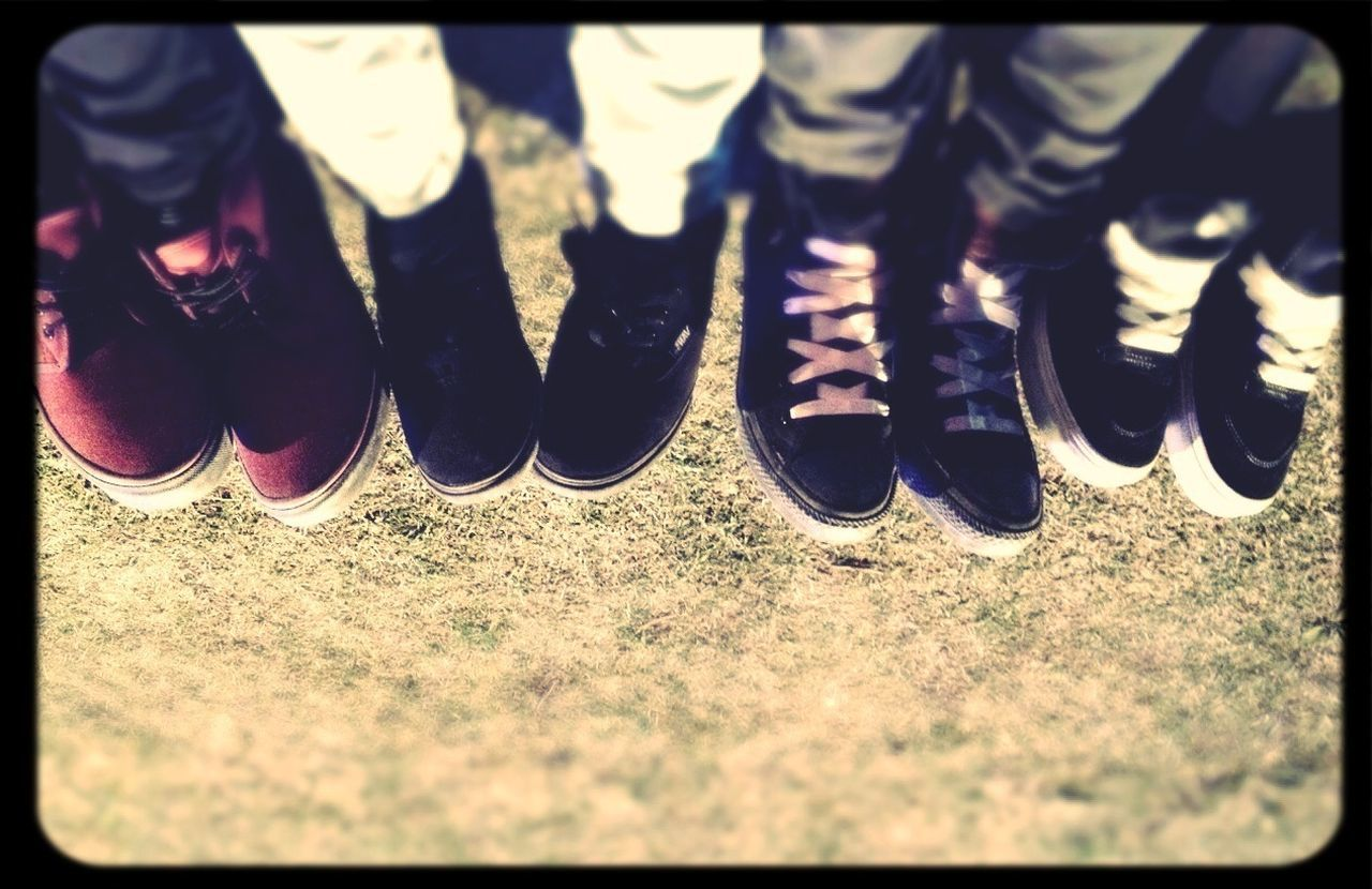 low section, auto post production filter, human leg, in a row, shoe, day, standing, real people, outdoors, human body part, close-up, people