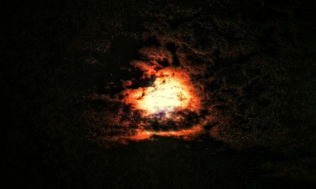 Heat - Temperature Night No People Burning Flame Luminosity Erupting Outdoors Nature Black Background Sky Galaxy