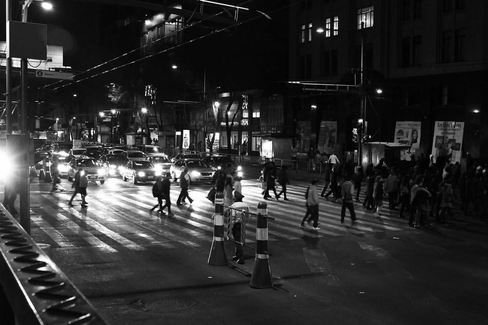 Battle Of The Cities City Life Building Exterior Street Night Lifestyles City Street On The Move Road Marking Illuminated City Large Group Of People Car Architecture Mexico City Streatphotograpy Black And White Crosswalk City Crosswalk StreatPhotography City Lights At Night City Life Crossing Zebra Crossing People Walking
