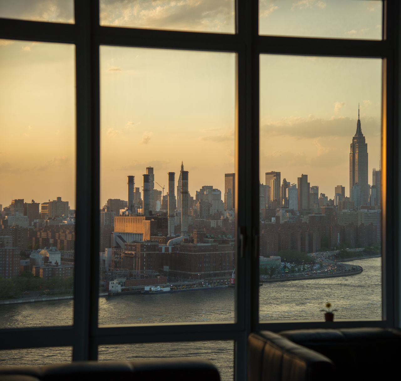 In Brooklyn looking at the Manhattan skyline at sunset Architecture City City Life Cityscape Empire State Building Framed From Brooklyn To Manhattan In Brooklyn Modern River Sky Skyline Skyscrapers Sunset Urban Skyline Waterfront Window Window View