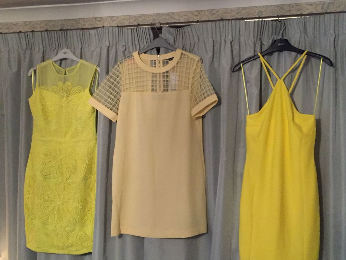 EyeEm Selects Clothing Hanging Fashion Dresses Style And Fashion In A Row Clothes For Woman Indoors  No People Variation Coathanger All Yellow Yellow Color