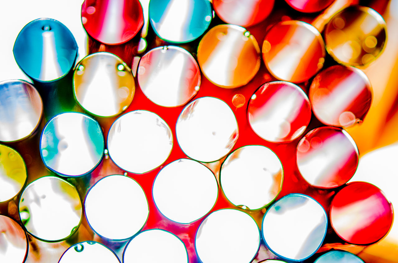 colourful drinking straw Circles Close-up Colorful Colors Colourful Colours Day Drinking Straw Drinking Straws Drops Drops Of Water Large Group Of Objects Macro Macro Photography Metallic No People Straw Waterdrops