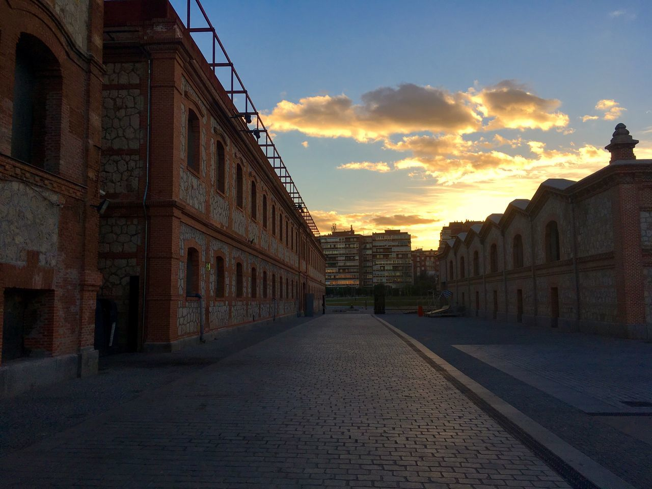 architecture, building exterior, built structure, sunset, sky, street, outdoors, the way forward, city, no people, day
