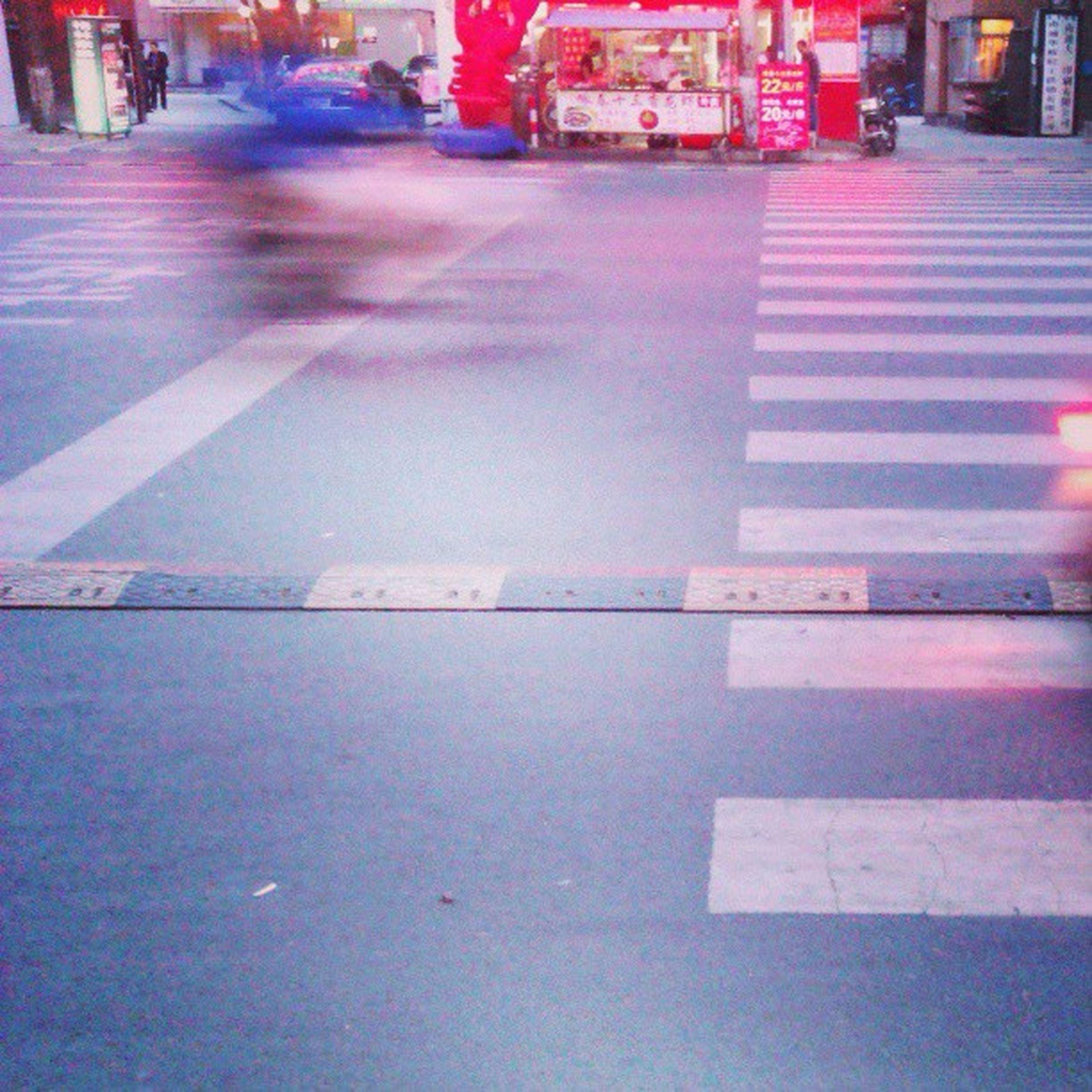 street, illuminated, city, night, transportation, reflection, road, building exterior, architecture, car, city street, built structure, city life, wet, road marking, incidental people, sidewalk, land vehicle, mode of transport, zebra crossing