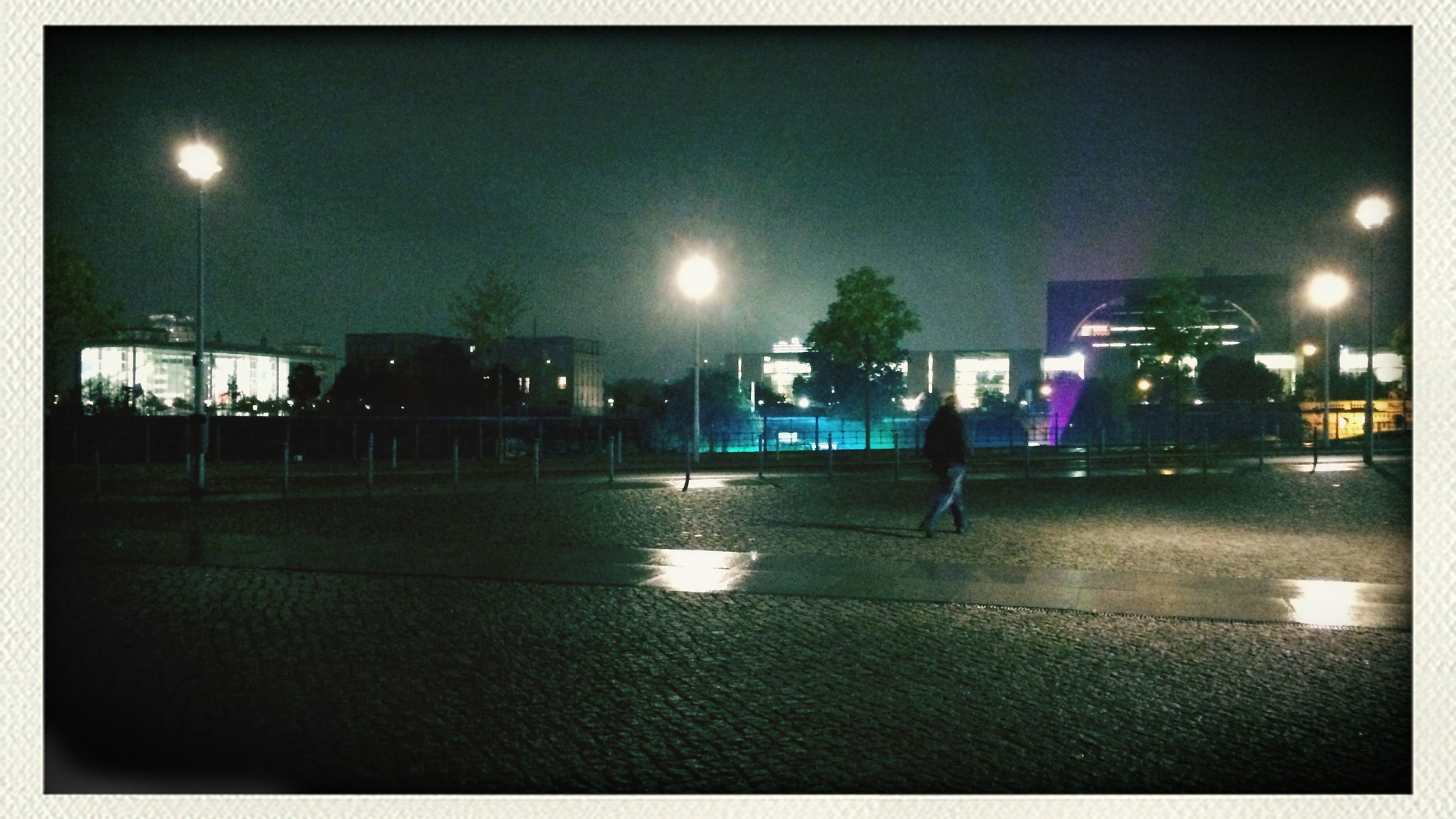 night, transfer print, illuminated, street light, auto post production filter, building exterior, architecture, built structure, lighting equipment, sky, city, light - natural phenomenon, dark, street, reflection, outdoors, clear sky, dusk, no people, moon
