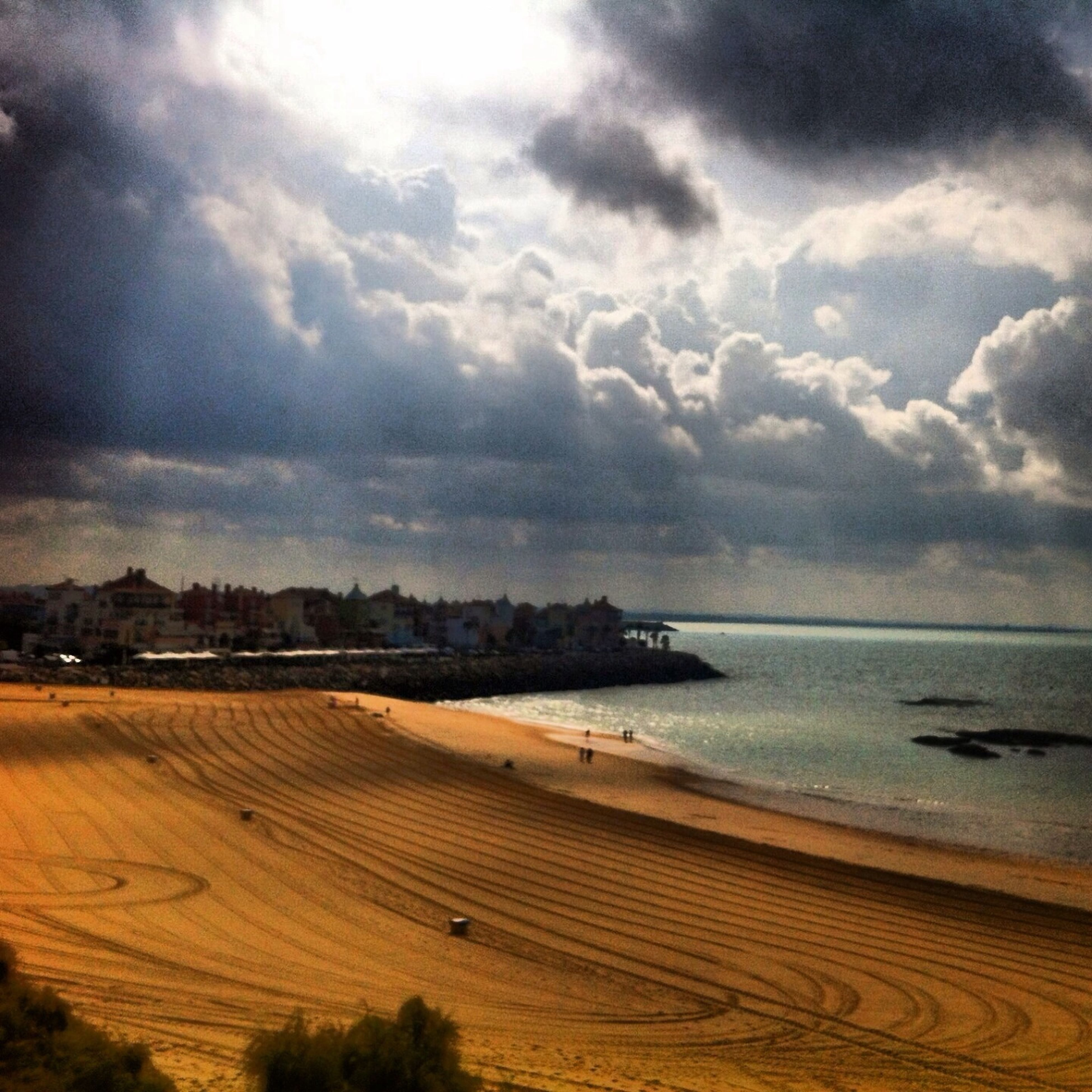 sea, beach, water, sky, horizon over water, shore, sand, tranquil scene, scenics, tranquility, beauty in nature, cloud - sky, nature, cloudy, coastline, idyllic, cloud, calm, outdoors, remote