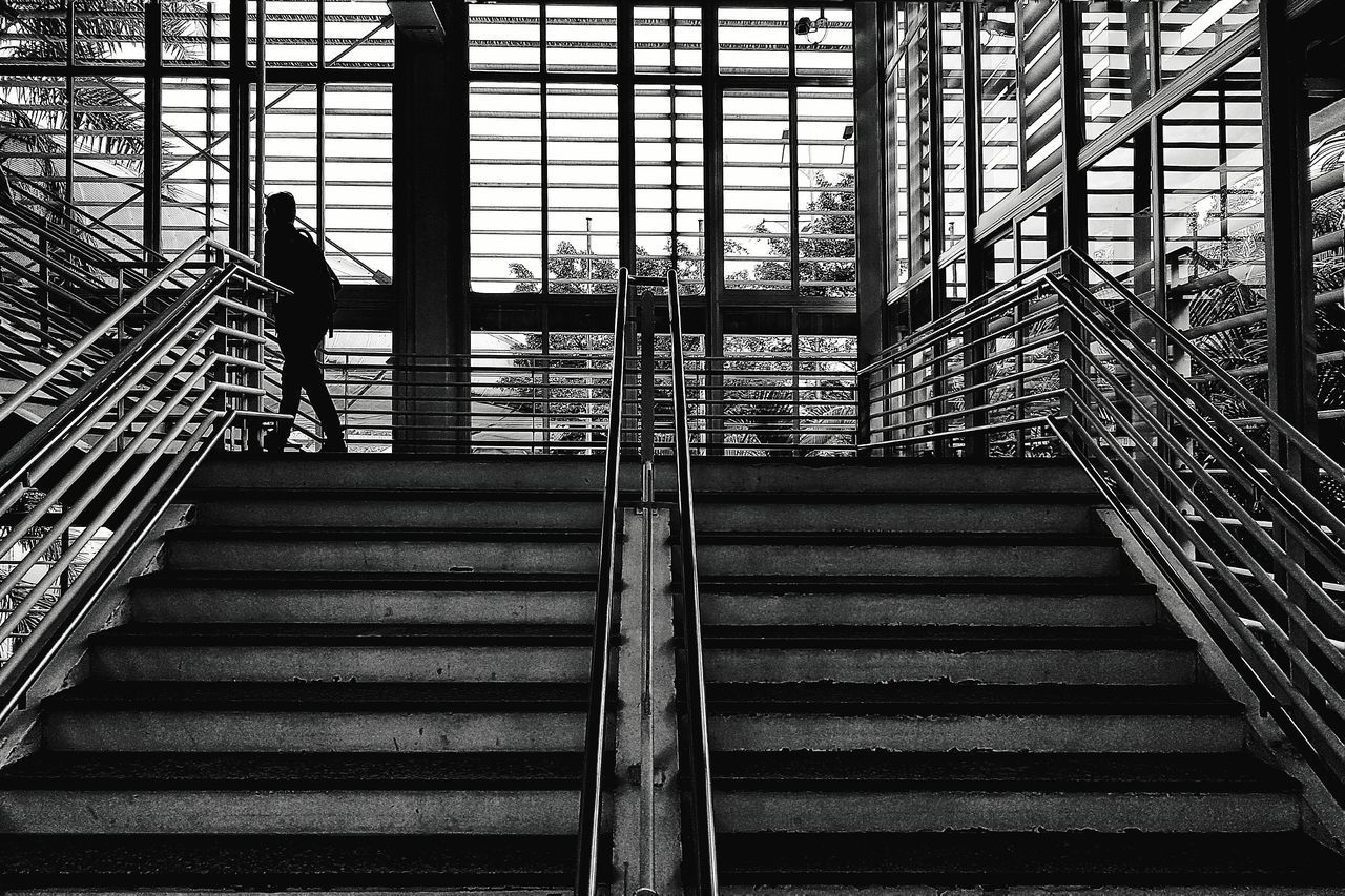 Railing Steps And Staircases Staircase Steps Day Built Structure Indoors  Architecture City Indoors  Young Adult Adult Adults Only Architecture Lines Blackandwhite Black And White The Street Photographer - 2017 EyeEm Awards