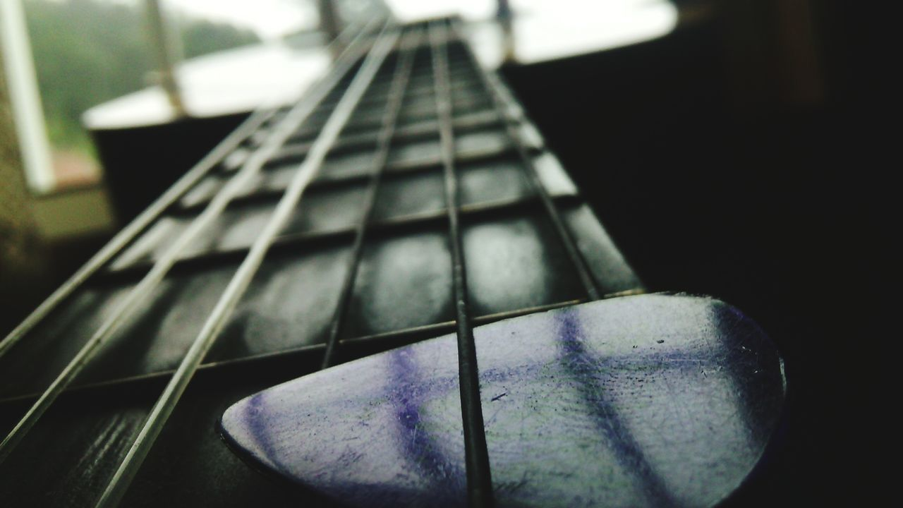 music, musical instrument, guitar, musical instrument string, indoors, arts culture and entertainment, close-up, fretboard, woodwind instrument, no people, day