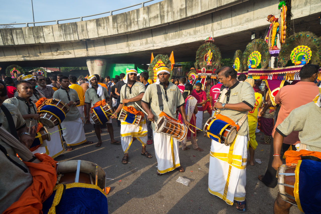 BATU CAVES, MALAYSIA - 9TH FEBRUARY 2017; Hindu devotees performing a pray session during Thaipusam festival in Batu Caves temple, celebrating Lord Murugan victory over the demon Soorapadman. Adult Arts Culture And Entertainment Batu Caves -Malaysia Celebration City Day Hindu Gods Men Music Musical Instrument Musician Outdoors Parade People Performance Group Performing Arts Event Playing Real People Saxophone Thaipusam 2017 Uniform Women