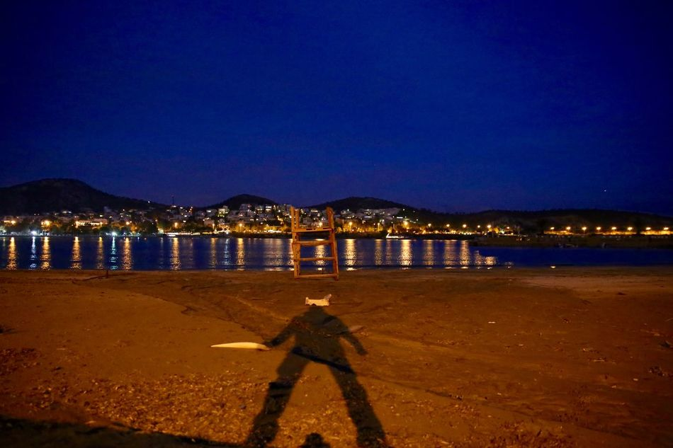 Shadow Warrior - GREECE Beach Beach Life Beach Night Beach Photography Beachlife Beachphotography Getting Away From It All Outdoors Reflection Sea Shadow Shadow Man Shadow-art Shadows Shadows & Lights Sky Standing Water Tranquil Scene Traveling Vouliagmeni Water