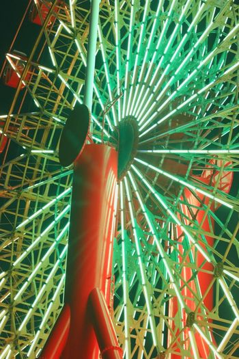 Low Angle View Amusement Park Arts Culture And Entertainment Illuminated Ferris Wheel Night Red Close-up No People Low Section Indoors  Amusement Park Ride Multi Colored Circle
