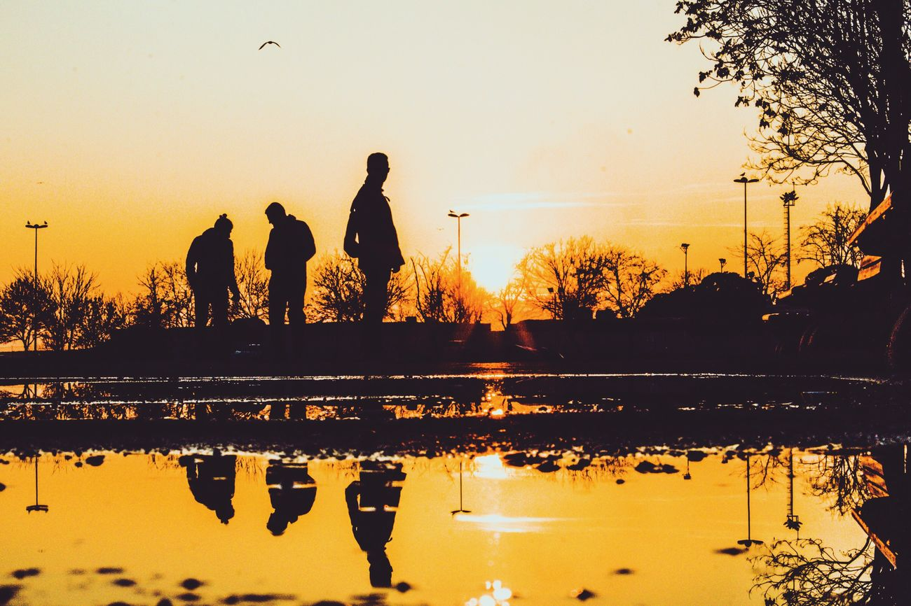 Reflection Sunset Silhouette Real People Water Leisure Activity Sky Lifestyles Outdoors Scenics Tree Nature Full Length Men Friendship Beauty In Nature Togetherness Day - Nature First Eyeem Photo One Man Only One Person The City Light People Adults Only The City Light