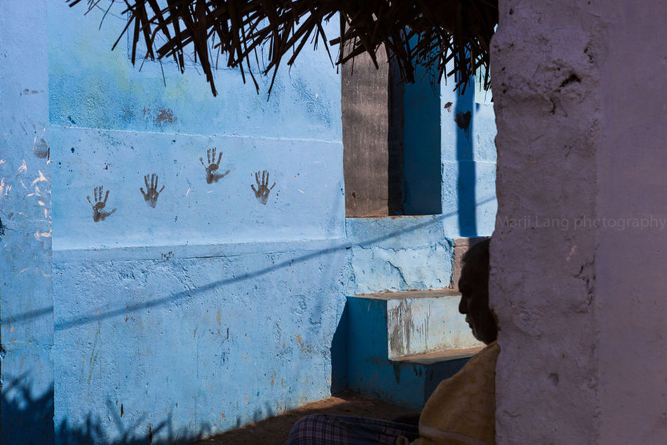 Street scene by a bright blue wall painted with hands, Kanyakumari, South India. Architecture Blue Blue Wall Building Built Structure Composition Contrast Day Hands Kanyakumari Light And Shadow Mans Outdoors Painted Silhouette South India Street Streetcorner Streetphotography Streetshot Summer Tamilnadu Wall Wall Wall - Building Feature