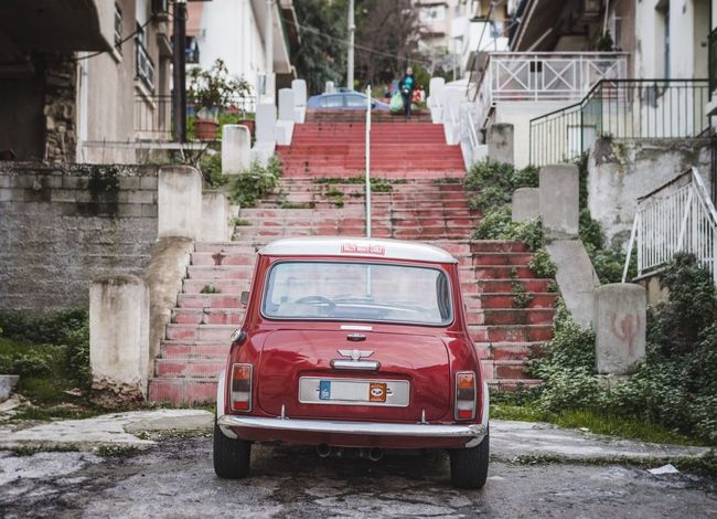 Red Mini Cooper In The City in front of Red Stairs | Urban Landscape Urban Exploration Cars Red Car Car Collection Street Photography Vintage Cars The Street Photographer - 2016 EyeEm Awards