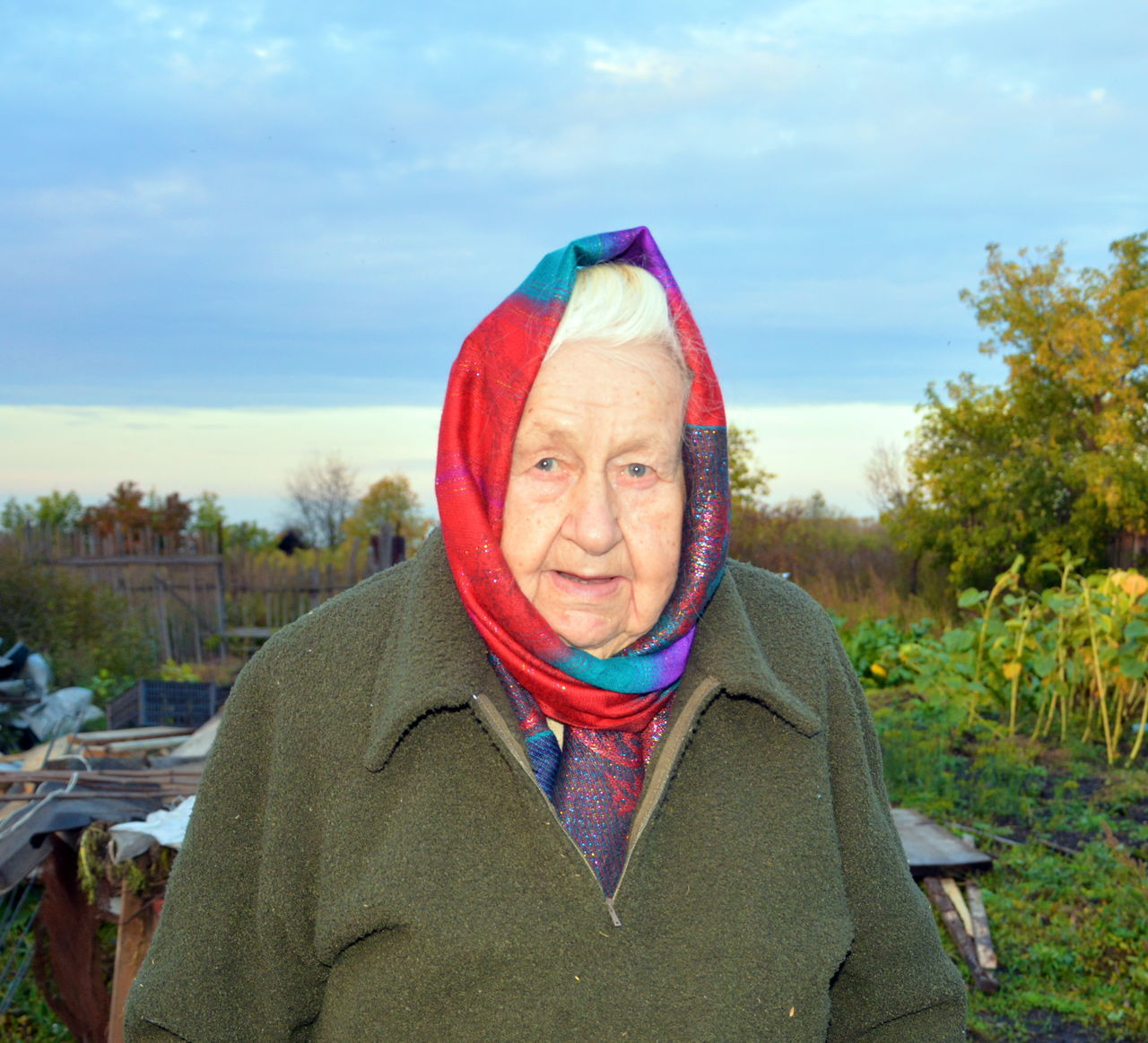 Portrait Of Senior Woman Wearing Headscarf Against Sky