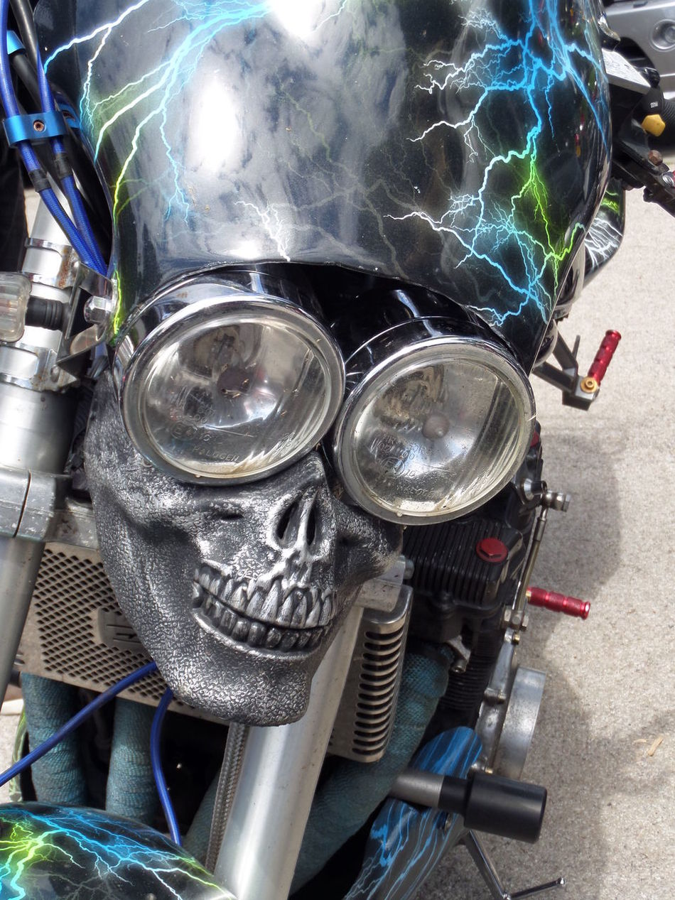 Close-up Day Fun. Headlights. Pink. Green. Shiny. Metallic. Chrome Bumper. American Style. Vintage 1950. Lights Machine Part Man Made Object Motorcycle. Enjoying Life :) Mptorcycle Headlights. No People Shiny Silver  Silver Colour. Skull Skull Motorcycle Headlights. Stationary Still Life