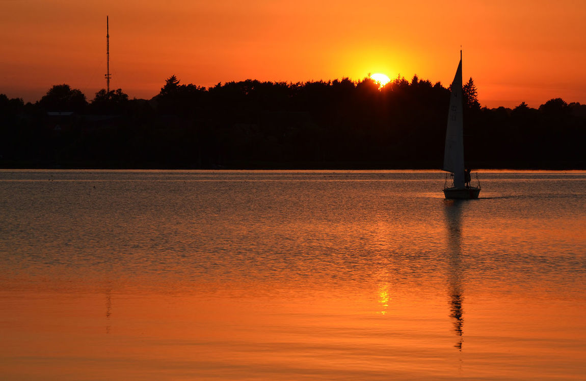 Back Lit Beauty In Nature Calm Camping Camping Place Lake Ratzeburg Nature No People Non-urban Scene Orange Color Outdoors Reflection Rippled Romantic Sky Sail Sailing Boat Scenics Silhouette Sun Sunlight Sunset Tranquil Scene Water